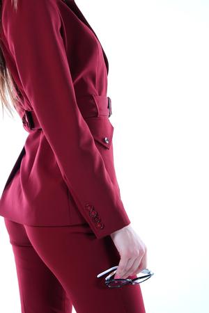 pantsuit: Modern wine-colored pantsuit model. Stock Photo