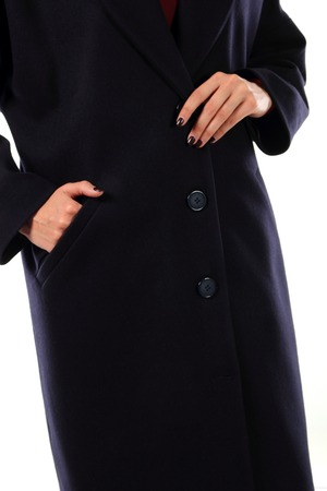 lapels: Young model dressed in black autumn coat