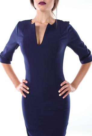 dark blue: Young model in the strict dress dark blue background.
