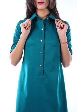 rigor: Young model in a a free cut dress emerald.