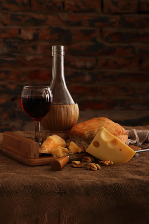 bottle of wine: Wine, cheese and homemade bread.