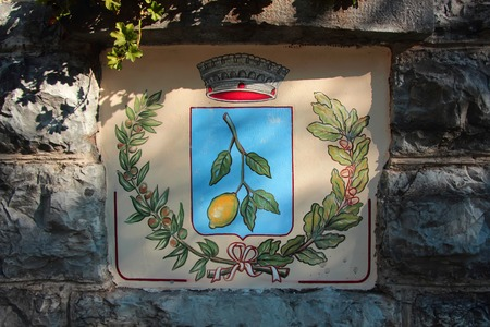 city coat of arms: Limone sul Garda, Italy, 2 November 2015,The coat of arms with the image of the city branch of lemon.