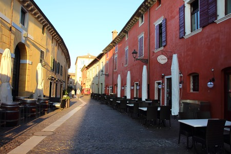 2 november: Bardolino, Italy, 2 November 2015, View of the street, where the cafes and restaurants on opposite sides. Editorial