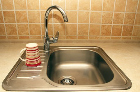 sinks: New faucets and sinks in the kitchen. Stock Photo