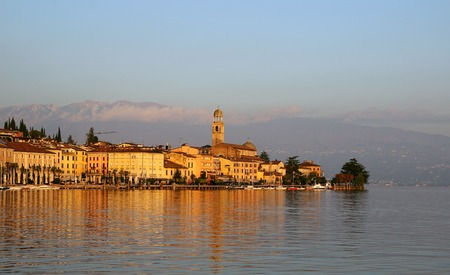 salo: Salo, Italy, October 30, 2015 View of the promenade of Lake Garda, lit by the sun. Stock Photo