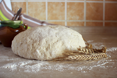yeast: Yeast dough on the kitchen table. Stock Photo