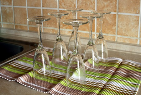 upside down: Empty glasses standing upside down on a towel.