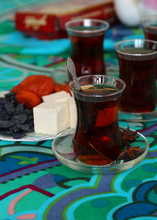 Tea in Turkish and oriental sweets. Stock Photo