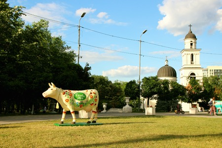 June 15, 2017, Chisinau, Moldova, View of the square at the Victory Arch and a statue of a cow against a lawn background. Editorial