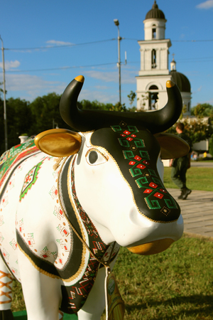 June 15, 2017, Chisinau, Moldova, View of the statue of a cow from the festival of cows on the background of the central cathedral. Editorial