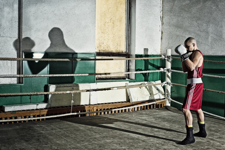 full lenght: Full lenght portrait of a boxer standing in the ring prepared for fight