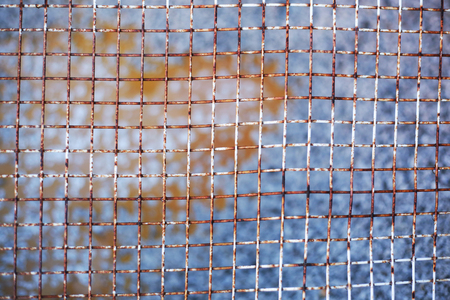 oxydation: detail of rusty mesh fence