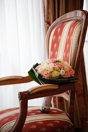 Photo taken in the Arcadia hotel room, detail shot of wedding bouquet placed on the padded chair