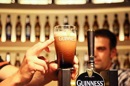 Pint of guinness placed on top of draft counter at Guinness Storehouse Brewery - 17.july 2012