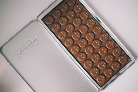 Close-up of a luxury chocolate with a cross pattern in an iron box on a white table Stok Fotoğraf