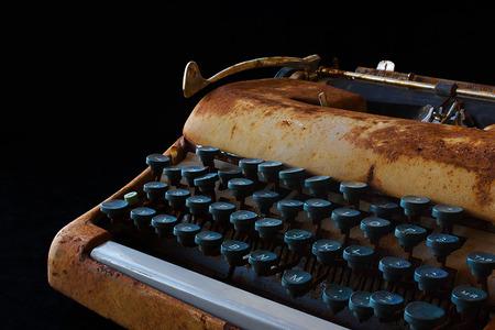 Typewriter, Waiting for Inspiration. Vintage Rusty Typewriter Machine. Journalist Equipment. Typewriter Close Up Isolated on Black Background.