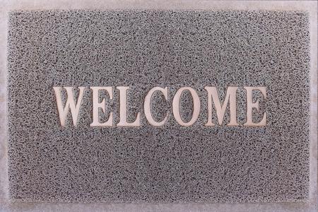 Welcome Door Mat With Female Feet Friendly Grey Door Mat Closeup