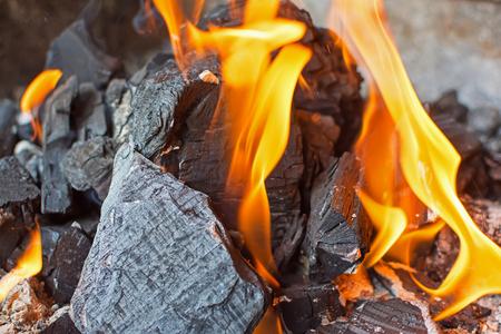 coals: Fire and Coals Close Up. Burning Fire Bright Flames. Hot Charcoal Briquettes.