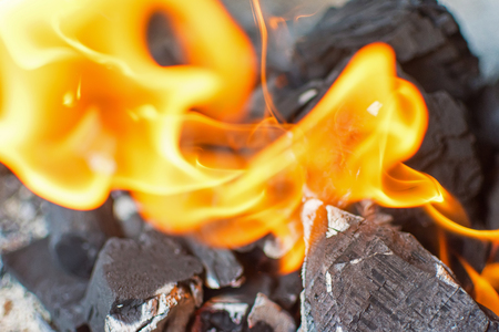 briquettes: Fire and Coals Close Up. Burning Fire Bright Flames. Hot Charcoal Briquettes.