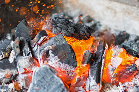 briquettes: Burning Charcoal Close Up. Hot Charcoal Glowing Briquettes. Stock Photo