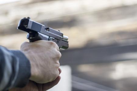 gun fire: Gun Fire Street Assault. Shooting a Handgun and Smoke Coming out of Barrel.