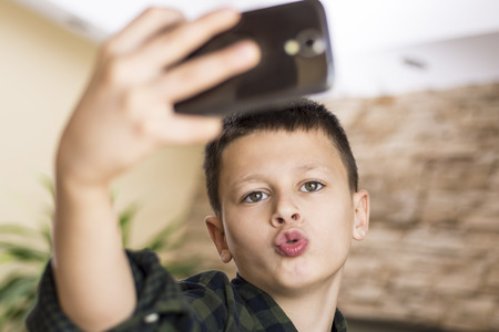 selfy: Funny Boy Taking Comic Selfie with Weird Expression