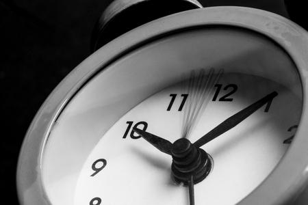 Alarm Clock on Black Background. Time Management Concept. Stock Photo