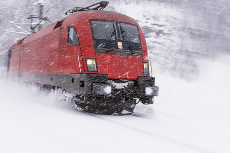 heavy snow: Fast Train in Heavy Snow Storm. Blizzard on Railway. Stock Photo