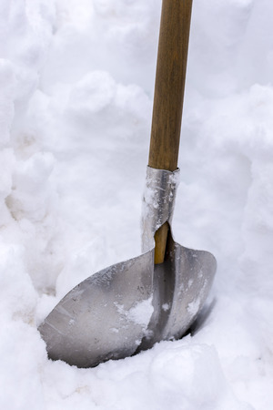 Snow Shovel in Heavy Snow. Cleaning Snow Winter Concept.