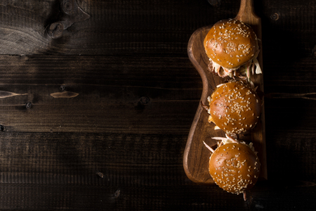 Homemade Mini Beef Burgers with Coleslaw Salad on Little Wooden Cutting Board. Barbecue Meat Sandwiches on Rustic Table. Stok Fotoğraf