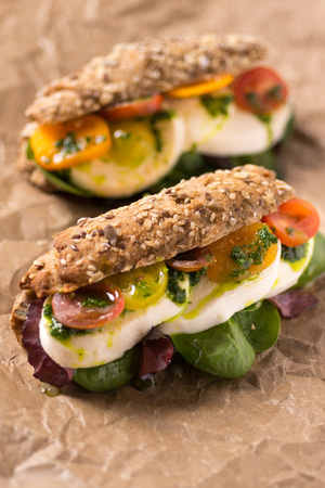Healthy Vegetarian Sandwich with Baby Spinach, Mozzarella Cheese and Grape Tomatoes