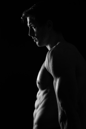 Sexy Shirtless Muscular Male Model on Black Background