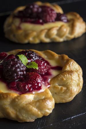 Vanilla Cream and Fruit Berry Puff Pastry Dessert on Dark Background