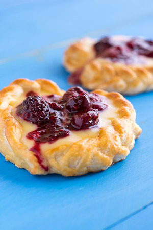 Vanilla Cream and Fruit Berry Puff Pastry Dessert on Blue Background