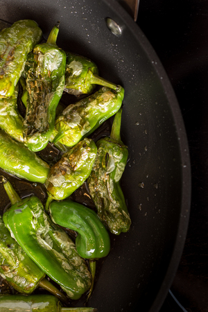 Green Padron Peppers Preparation in the Frying Pan