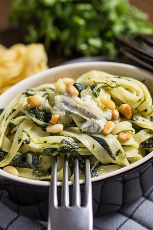 Freshly Prepared Tagliatelle with Spinach, Pine Nuts and Gorgonzola Cheese