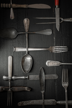 Rustic Silverware on Dark Wooden Background. Stock Photo