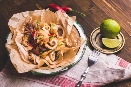 Squids Calamari Tentacle with Chili Pepper on Rustic Wooden Background