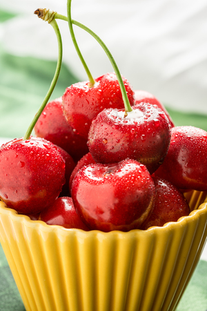 Fresh Red Cherries Splashed by Water in Bowl