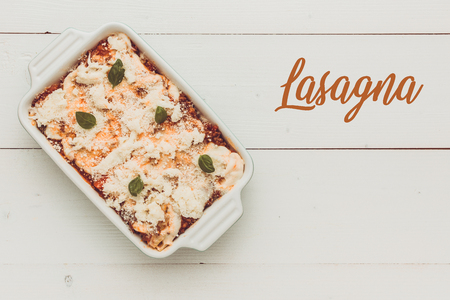 Lasagna Bolognese with Beef, Bolognese Sauce and Basil Ready for Baking