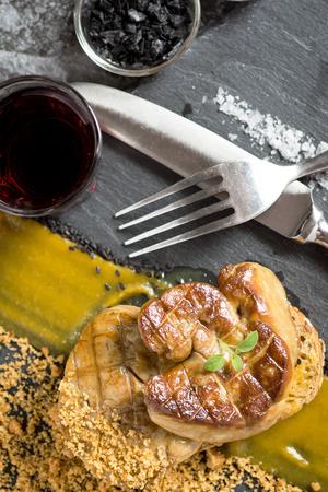 Foie Gras with Mango Puree on Dark Stone Background. French Cuisine Duck Liver Dish.