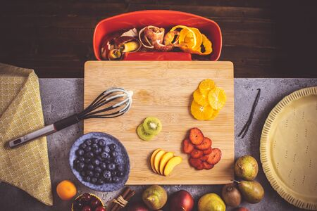 Tart Pie Prepare with Colorful Fruits and Fresh Dough on Cutting Board. Healthy Eating Food Concept.
