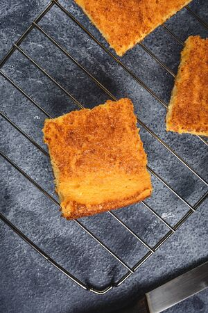 Yellow Corn Bread Squares Slices on Dark Rustic Background
