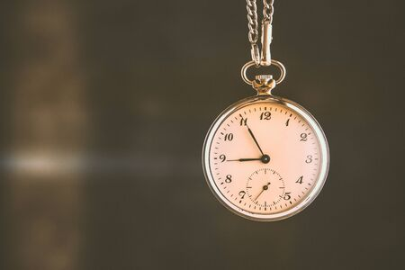 Rustic Pocket Watch. Deadline, Running Out of Time and Urgency. Time Passing Concept.