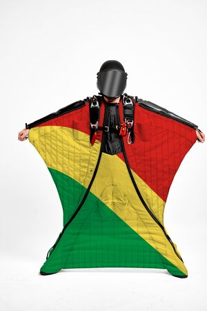Congo extreme. Flag in skydiving. People in free fall grab flag of Congo. Patriotism, men and flag. Standard-Bild - 134789490