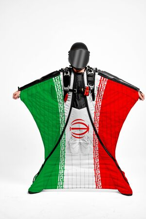 Iran extreme. Flag in skydiving. People in free fall grab flag of Iran. Patriotism, men and flag.