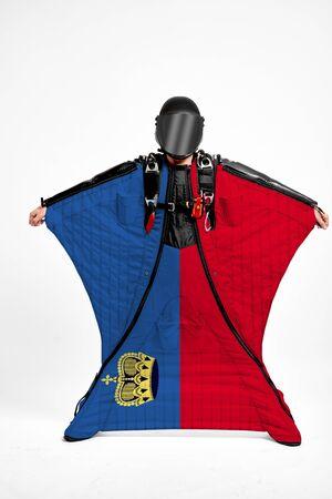 Liechtenstein extreme. Flag in skydiving. People in free fall grab flag of Liechtenstein. Patriotism, men and flag.