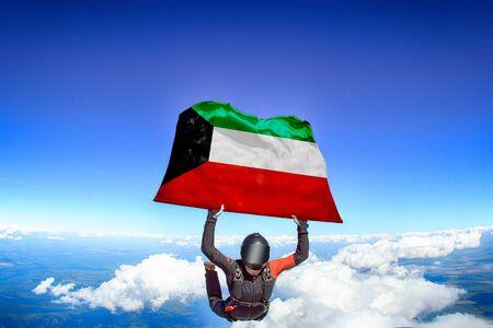 UAE extreme. Flag in skydiving. People in free fall grab flag of UAE. Patriotism, men and flag.