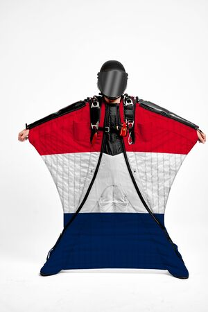 France extreme. Flag in skydiving. People in free fall grab flag of France. Patriotism, men and flag.