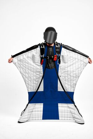Finland extreme. Flag in skydiving. People in free fall grab flag of Finland. Patriotism, men and flag.